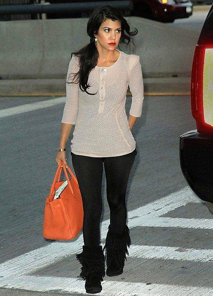 Kourtney Kardashian turns heads as she makes a casual but